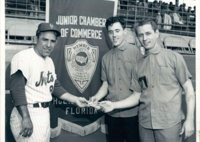 Photo of Yogi Berra with Jaycees Jeff Smallberg & Tom Waugh at Game Photo dated Apr 2, 1966